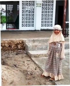 Ramadan in Baikpapan: Little girl with new outfit for holidays.