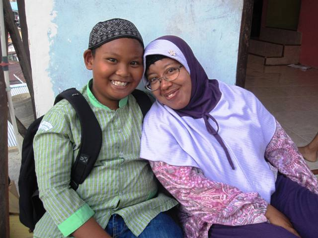 Mother and son, hanging out before dusk in their kampung.
