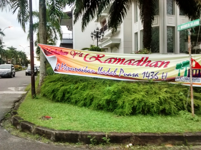 Ramadan in Balikpapan: Banners like this, and giant posters showing political leaders in their best Muslim attire are found all over town.