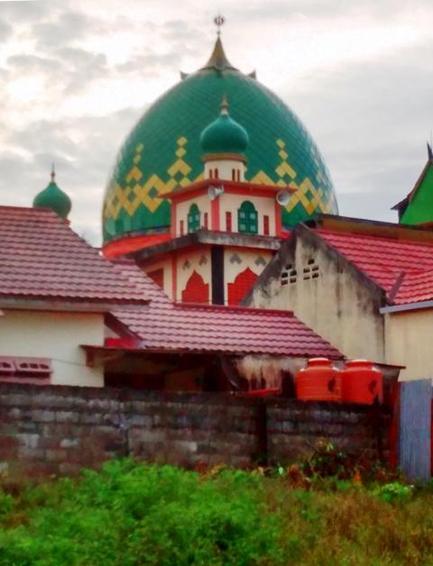 Ramadan in Balikpapan. Mosque between kampung homes, taken during Saturday Hash.