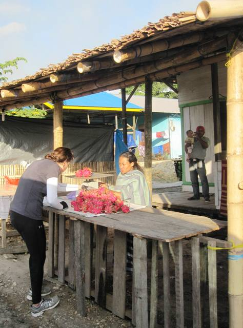 Buying Dragon Fruit at Roadside Stall. Balikpapan, Kalimantan, Indonesia