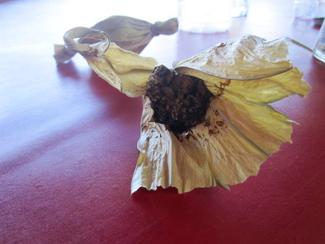 Halua snack made from Kenari nut and palm sugar, wrapped in pandanus leaf. A lady was selling them at the stall, 3 for 10,000 rupiah.