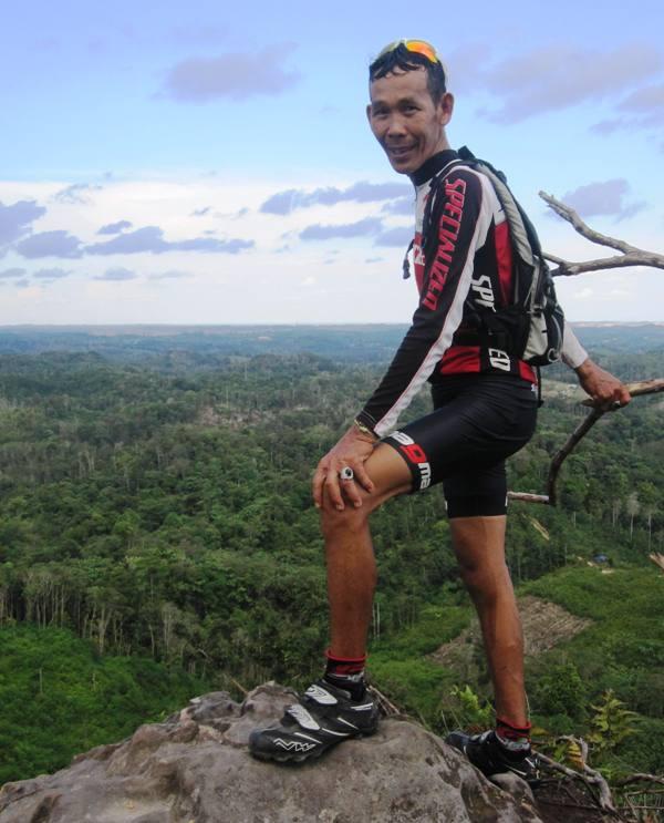 Pak Yayan on top of Bukit Dinding