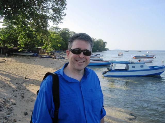 Sam on south end of Bunaken, mangrove behind him lead to east side
