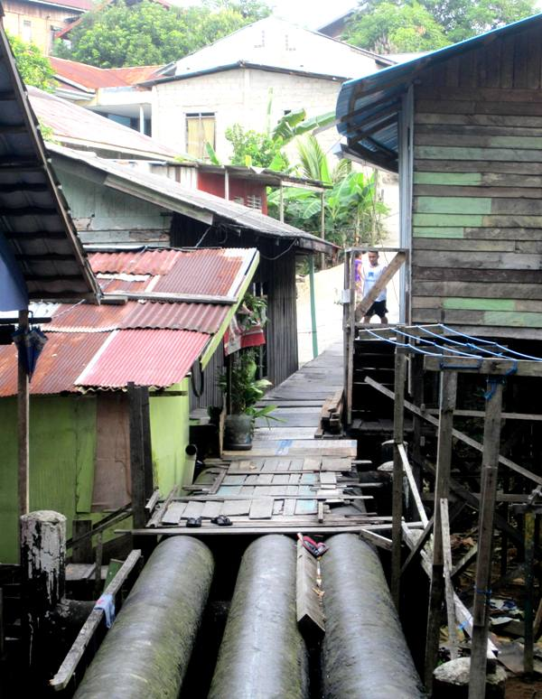 Boarded up Pertamina Water Pipes