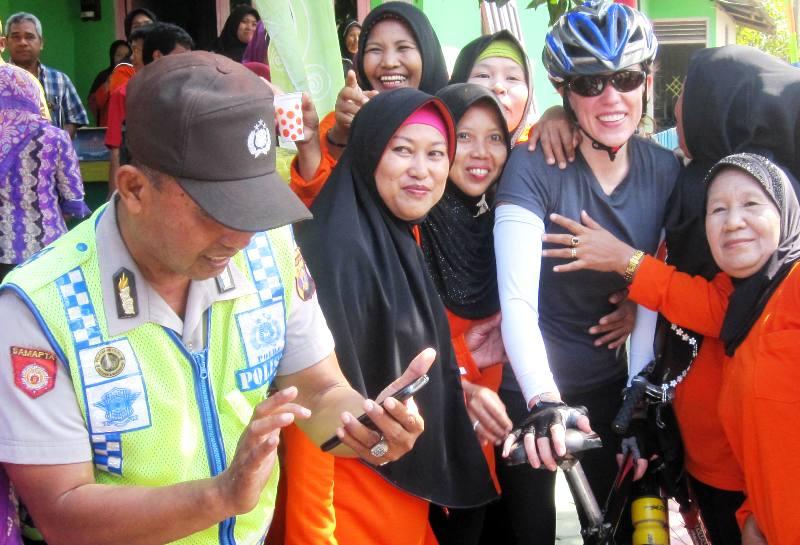 Ibu Ibu and Police photo opp.Balikpapan Village, Indonesia