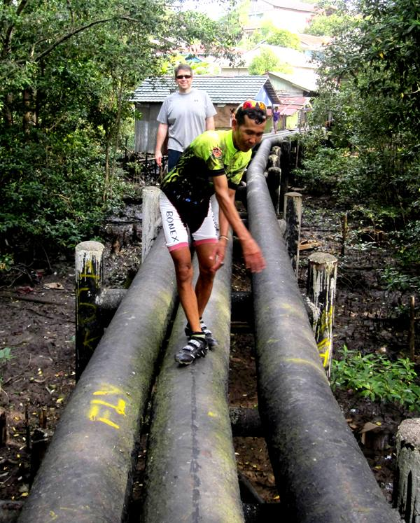 Pertamina Water Pipes Leading from Kampung over Mangrove and River