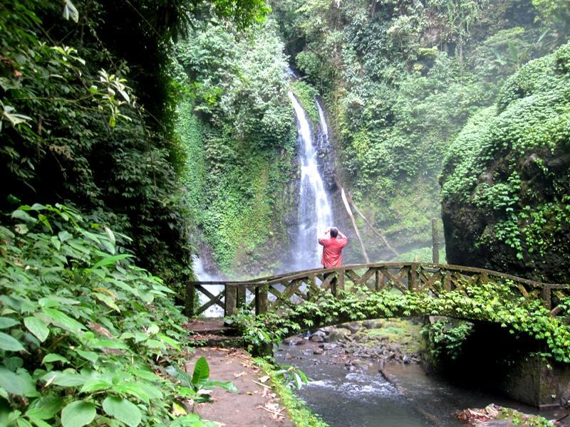 Sam in front of Kali Waterfall.Manado Sulawesi