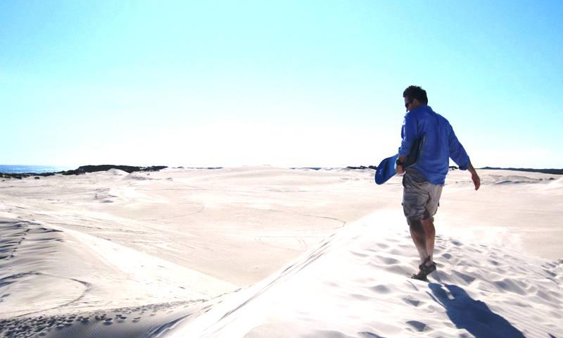 Sand surfing at Lancelin Dunes.Western Australia