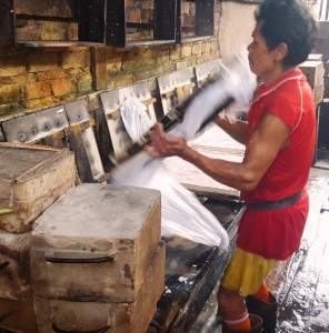 Flipping pressed tofu molds.Indonesia tofu factory