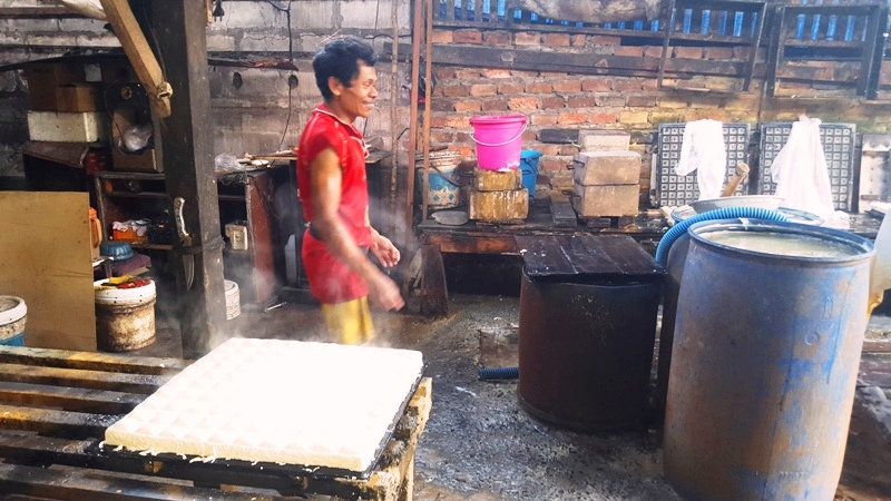 Molded tofu before cutting. Tofu factory in Balikpapan, Kalimantan Indonesia