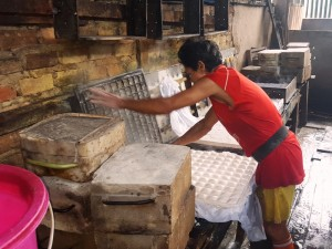 Opening finished tofu molds. Balikpapan, Indonesia tofu factory