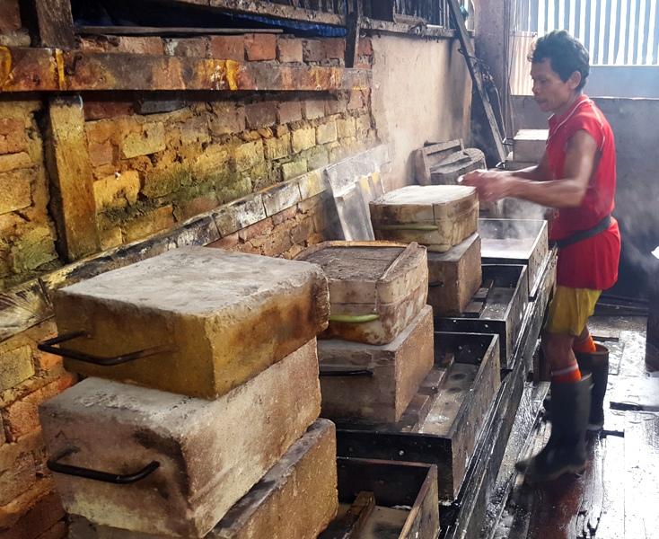 Pressing tofu molds.Balikpapan, Kalimantan, Indonesia tofu factory