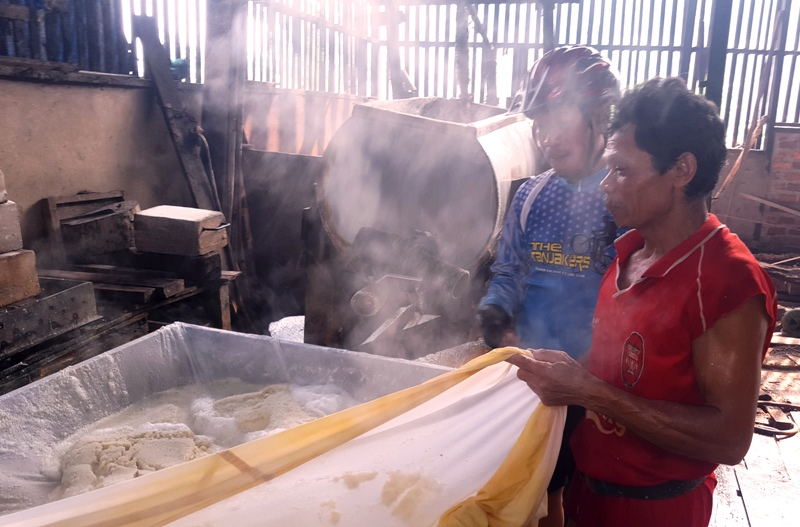 Sieving the soy pulp from soy milk. Balikpapan, Indonesia Tofu Factory