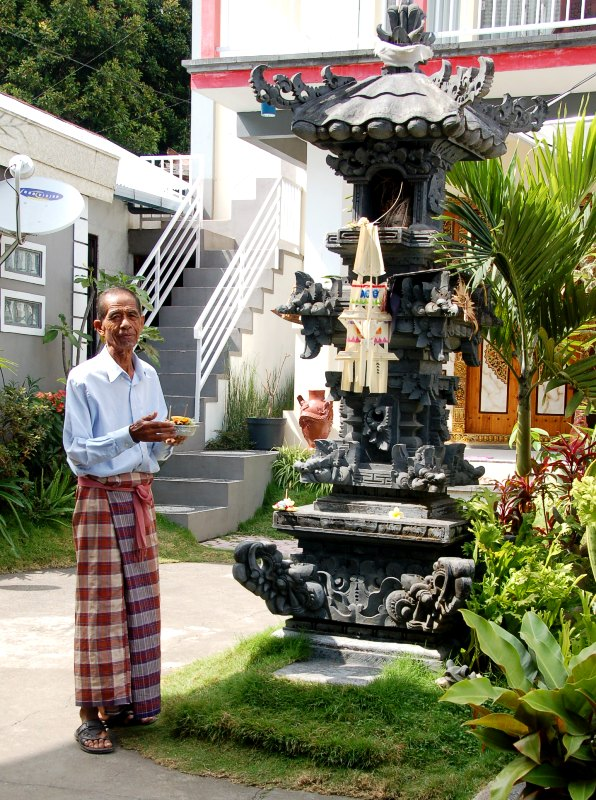 Patriarch presenting daily offering to spirits of ancestors.Munduk BaliPatriarch presenting daily offering to spirits of ancestors.Munduk Bali