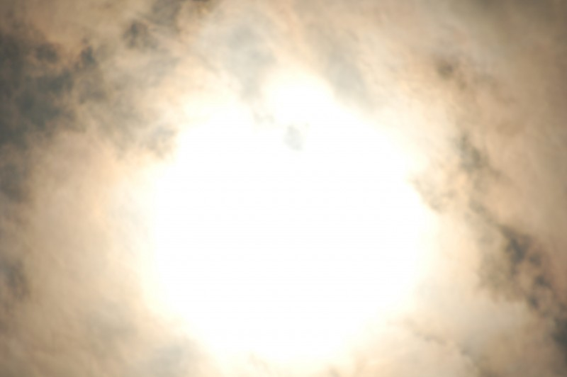 Unfiltered Total Solar Eclipse Nearing Totality with Clouds Dissipating