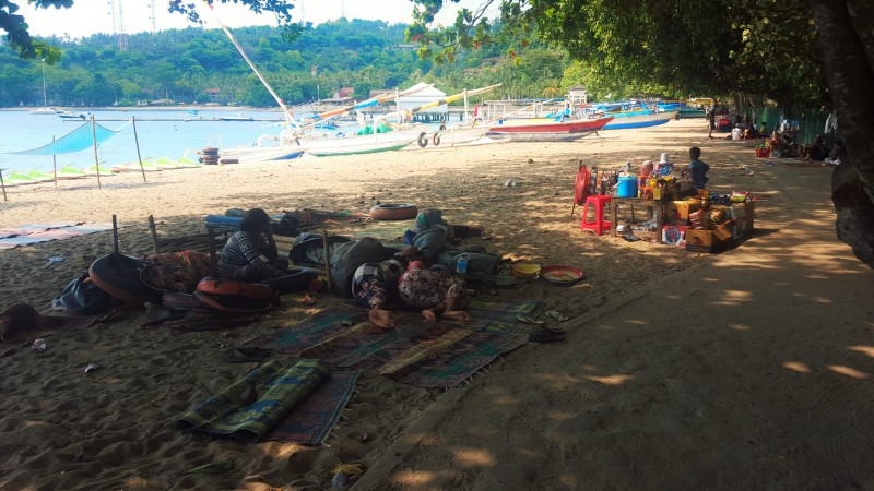 People napping by private boats and ferries to Gili islands by Kila Senggigi Beach Resort, Senggigi, Lombok