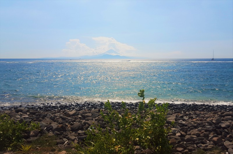 Viewing the volcanoes of Bali in the distance off Senggigi Beach, Lombok, Nusa Tenggara