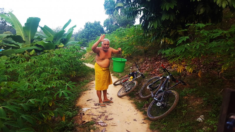 Man on the way to a village bathing area in outskirts of Balikpapan, Indonesia