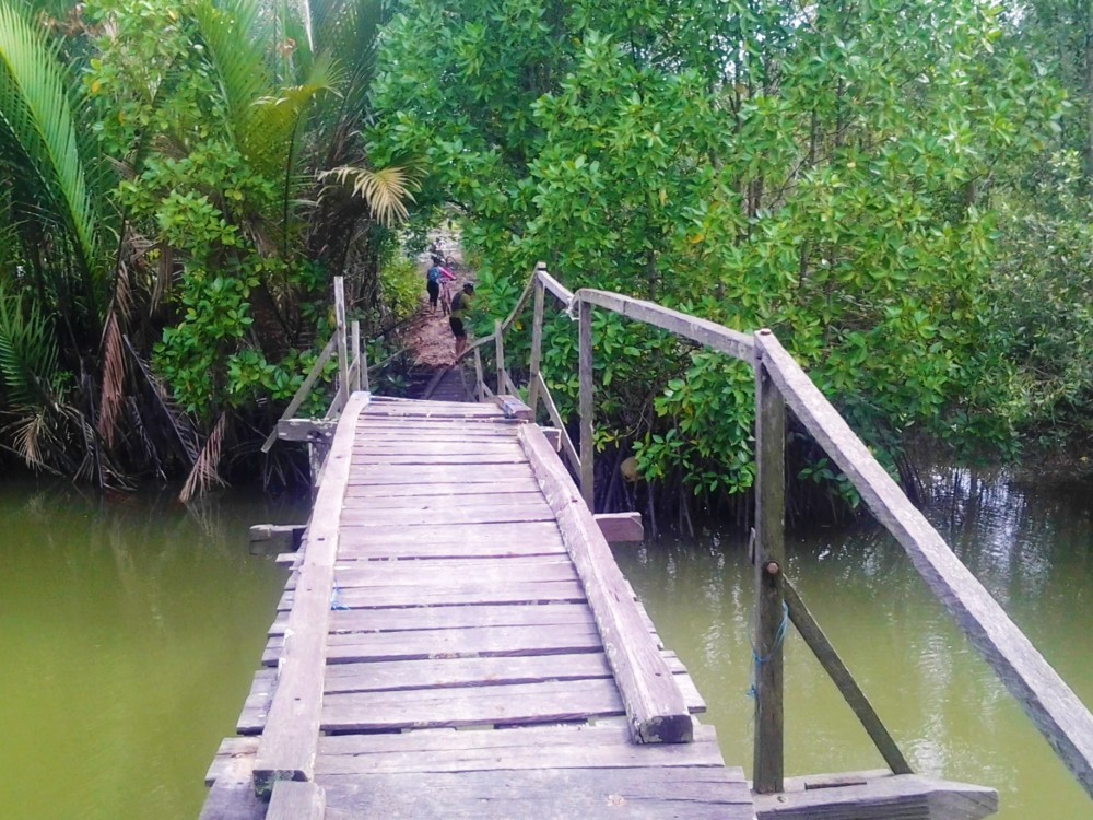 Crossing bridges near Manggar/Teritip area on a cycling trip, Balikpapan, Indonesia
