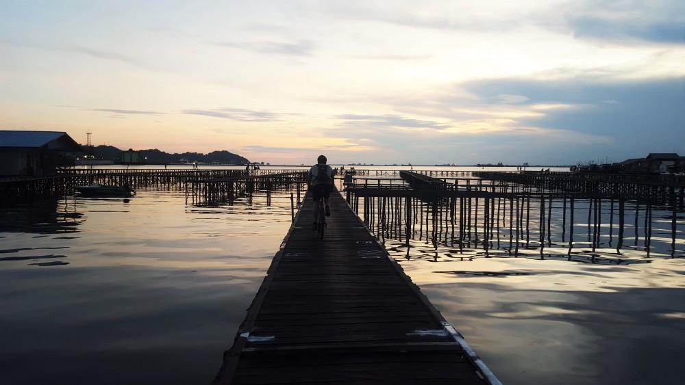 Riding through water village at Sunset. Kampung Baru, Balikpapan, Indonesia