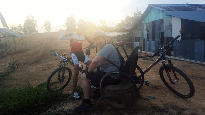 Taking a rest during a bike ride through Balikpapan villages and plantations.Borneo, Indonesia