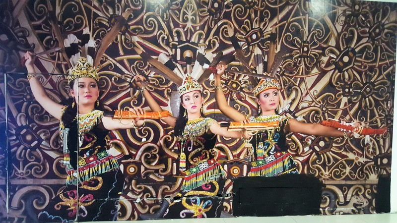 Funny picture of faux Dyak dancing ladies at Balikpapan Airport