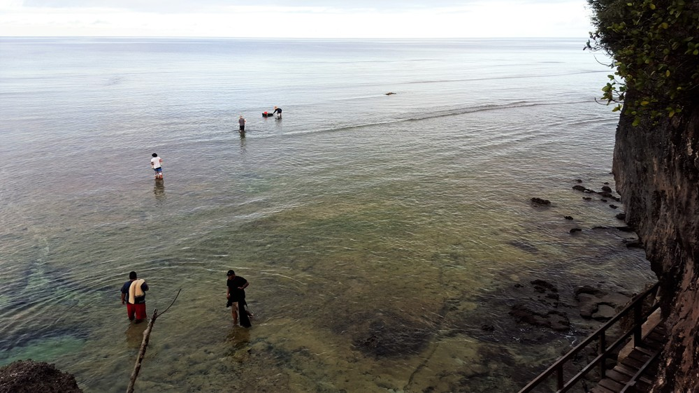 Fishermen at low tide in Tumon Bay, Guam